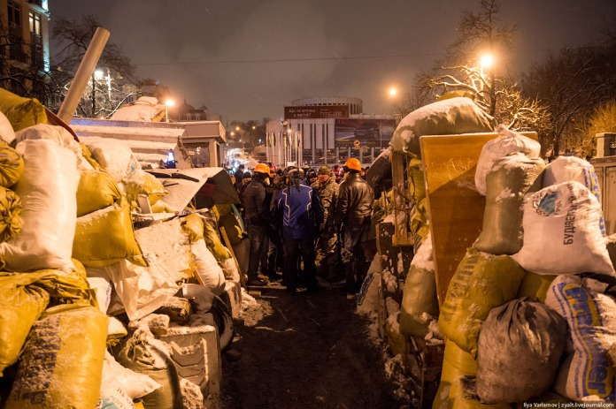 Mihaila Grushevskogo street. The first barricade has been erected here. The guards do not allow in outsiders. Only the press, the volunteers, and the activists, ready to fight Berkut  (Ukranian SWAT), are allowed to pass. All onlookers are stopped at the approach, to prevent them from interfering with work.