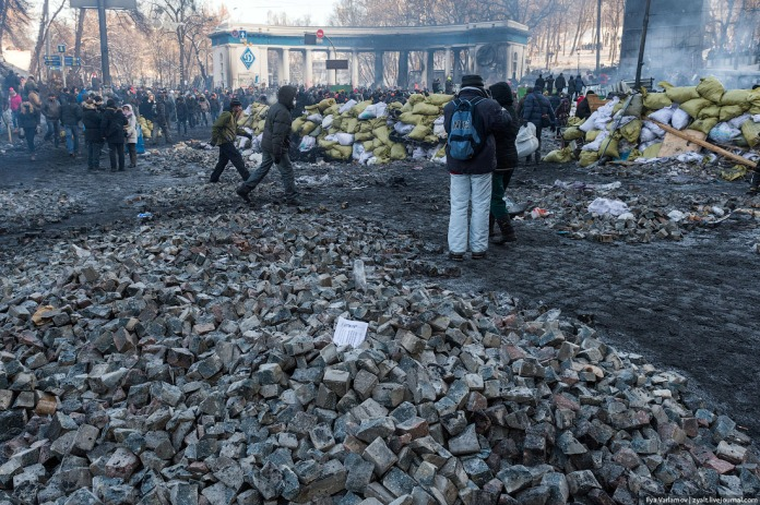 The Maidan's quarries. People break the street into easy-to-throw stones, load them into sacks and bring them to the frontline.