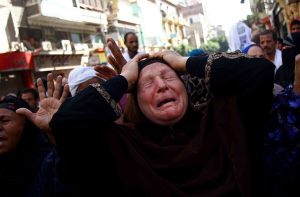 Egyptian woman mourns following verdict sentencing 683 alleged supporters of Muslim Brotherhood to death (Photo: AP)