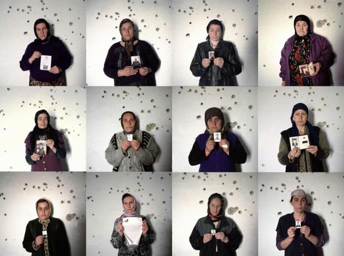 Argun, Chechnya, 2002. International Women's Day. 12 Chechen women showing portraits of their missing male relatives. Source: Thomas Dworzak via Fotojournalismus (Tumblr)