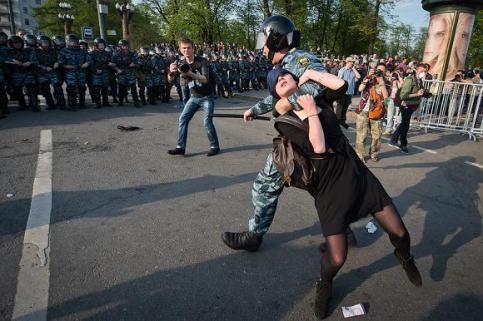 The arrest of Alexandra Dukhanina. She was accused of throwing pieces of asphalt at a policemen. and she is facing up to thirteen years