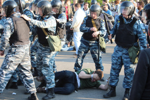 Alexei Gaskarov (on the ground, under attack by police) on the 6 May 2012 demonstration. Souce: Grani.ru