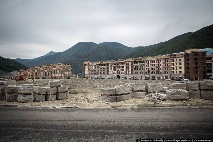 Vast wasteland of structures left incomplete, unable to finish in time for the Olympics. Pallets with paving slabs have lain intact and abandoned since winter.