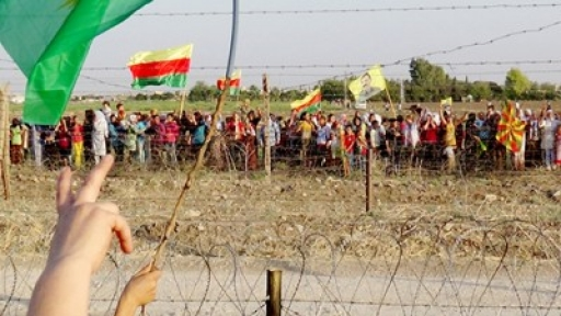 The solidarity demonstrations are greeted by Rojava residents from across the border