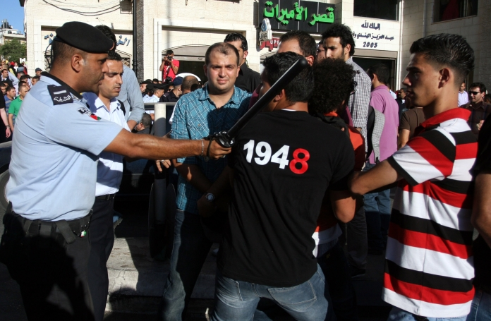 "Police block and attack young protestors from the ""End the Palestinian Division"" Campaign . Picture taken July  2012"