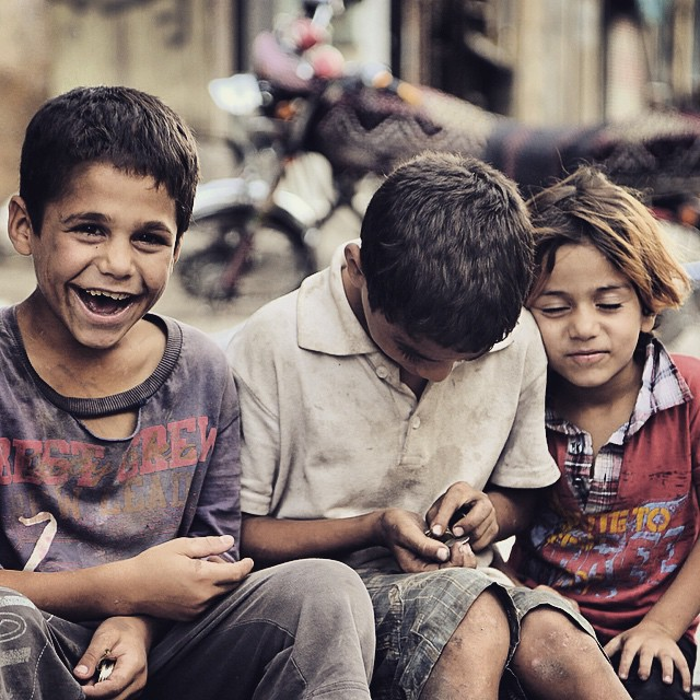 Older brother counts the day's earnings as little sister shows pure thankfulness that her guardian is there to protect her. She loves him as siblings should love each other; its just ugly that war and terrible circumstances are needed to show this beautiful reality. I can't get enough of these kids, somehow their faces explain everything that happens in Syria. Not sure how to explain it but hope the pictures will help.
