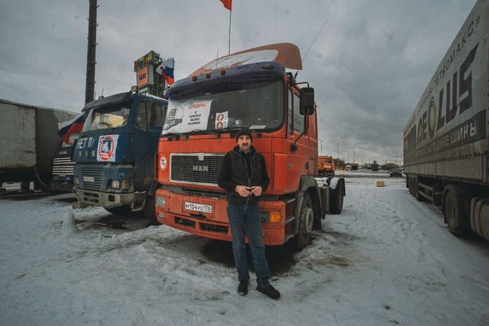"Arkady, 54. Owns his own truck. Has worked in heavy freight haulage since 1983. Is a teetotaler. Has driven round the entire country: the farthest he has ever driven was Blagoveshchensk. Hauled ""Cargo 200"" loads during the war in Afghanistan."