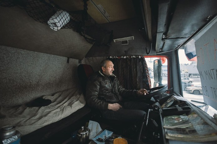 Vadim, 45. Owns his own truck, a 2000 Volvo. Previously drove a KamAZ. After his house was destroyed by fire, rebuilt it with his own hands. Married with two daughters.