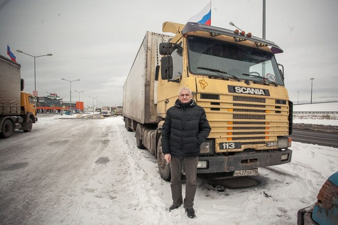 Vladimir, 49. Has lived and worked in Petersburg since 1997. After his wife's death, has had to raise his 5-year-old daughter alone. Used to work a three-days-on, three-days-off schedule, driving garbage to a penal colony for recycling. But with a young child to raise, had to change his schedule and in recent years has done intracity freight hauls.
