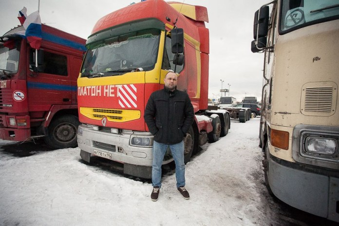Oleg, 37. Has lived in Petersburg since 2001. Used to drive himself, but around 10 years ago,, registered an individual enterprise and hired a driver to run his rig. Married with two children. Was among those detained by police on the first day of the protest.